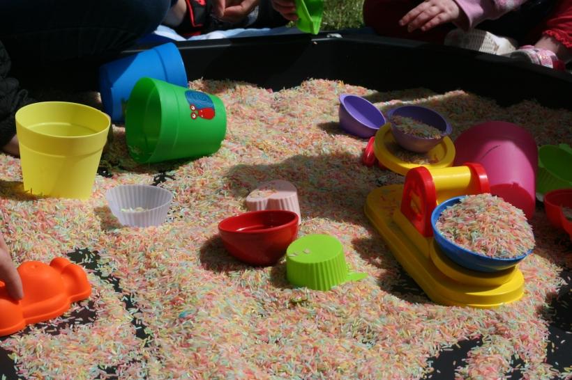 multi-coloured rice sensory play